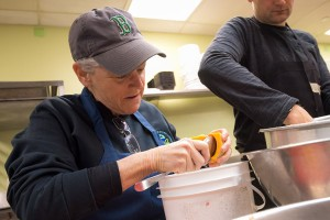 Administrator Gina McCarthy prepares food in Miriam's Kitchen
