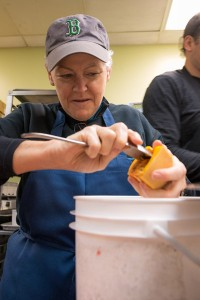 Administrator Gina McCarthy prepares food at Miriam's Kitchen