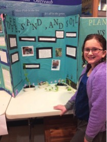 Science Fair participant : Anastasia Kaldy in front of her group's project – effects of soil types