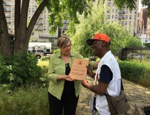 EPA's Judith Enck presents Troy Lancaster with an Environmental Champion Award.