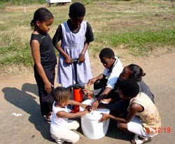 "Me (in all black) with the Swaziland ""bucket brigade."""