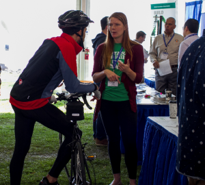 A student competitor at a previous year's Expo explains her team's project to an attendee.