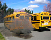 School bus with black smoke.